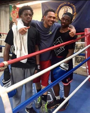 Malik Parker, right, pictured here after a sparring match at coach James Dixon's boxing gym, died March 19, 2021, less than a month after he was shot while leaving a high school basketball game. He was 17.