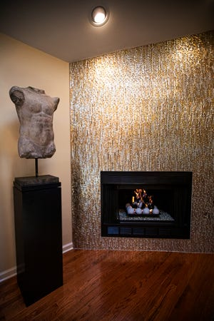 A Greek torso sculpture is featured next to the fireplace in Don Kavanaugh's home in the Oak Park neighborhood of Clark County, Indiana.