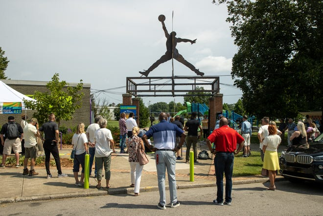 Spectators look on during a press conference at the Southwick Community Center announcing the rebranding of the Louisville Parks Foundation to the Parks Alliance of Louisville and its new 'Parks for All Equitable Investment Initiative'. Aug. 10, 2021