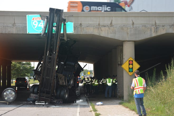A dumpster delivery truck struck an overpass on Moorland Road and I-94 in Brookfield Tuesday morning, Aug. 10.