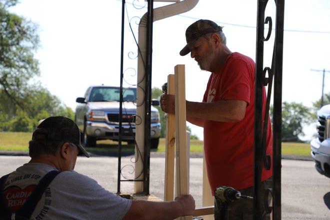 Volunteers work outside the Bob Davis Veteran Center. Thunder Rally has spent $300,000 dollars in renovating the centers building.