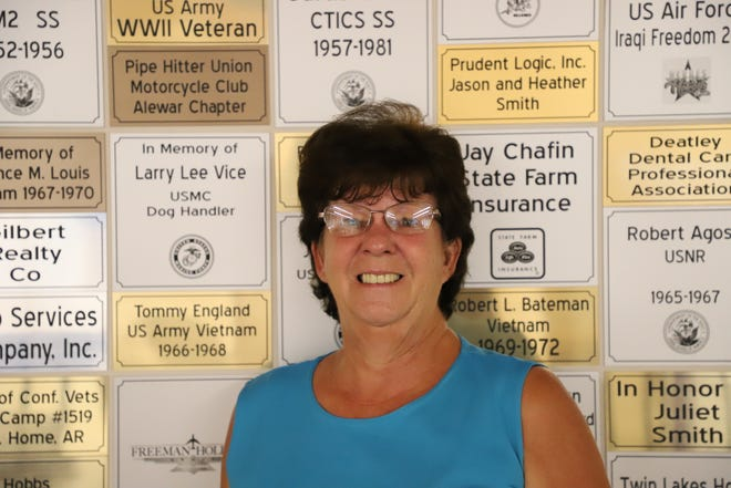 Joanna Farris poses in front of the Bob Davis Veteran Center's donation wall. Farris said the center is aiming to open in mid-September.