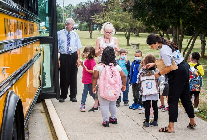 Grissom Elementary School students are dismissed to return home after their first day of school Tuesday, Aug. 10, 2021. Muncie Community Schools allowed students back with the requirement that they wear masks to prevent the spread of COVID-19 per CDC guidelines.