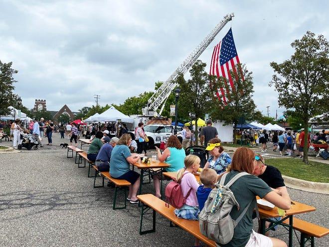 An enormous American flag flies over the Farmington Farmers Market corn roast on Aug. 7.