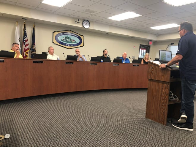 Paul Blake of Blake Farms speaks to the Lyon Township Planning Commission about plans to partner with Lombardo Homes and run orchard operations at the current Erwin Orchards property.