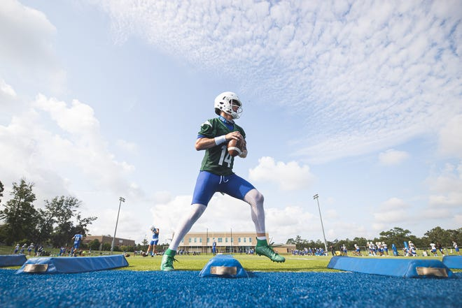 UWF quarterback Austin Reed goes through a drill during UWF's first day of preseason practice on Aug. 9, 2021 at Pen-Air Field.