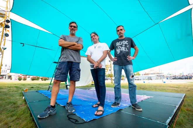 Brothers Brian, Scott and Dave Dambacher pose for a portrait Tuesday, Aug. 10, 2021, in the open-air theater constructed behind Raven Cafe in downtown Port Huron. The brothers are spearheading two productions that will be held in the theater on weekends from Aug. 13-Sept. 5.
