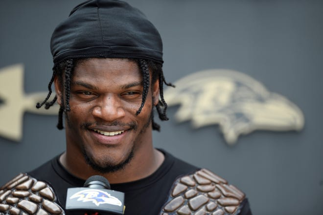 Baltimore Ravens quarterback Lamar Jackson answers questions from reporters after an NFL football practice, Monday, Aug. 9, 2021 in Owings Mills, Md.(AP Photo/Gail Burton)