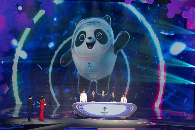 FILE - In this Sept. 17, 2019, file photo, Bing Dwen Dwen, the official mascot for the 2022 Beijing Winter Olympic is revealed at a ceremony at the Shougang Ice Hockey Arena in Beijing. Groups alleging human-rights abuses in China are calling for a full boycott of the Beijing Olympics, which is sure to ratchet up pressure on the International Olympic Committee, athletes, sponsors, and sports federations.  (AP Photo/Ng Han Guan, File)
