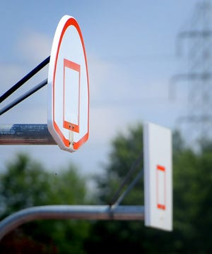 The basketball hoops on the courts at Cousler Park, Tuesday, Aug. 10, 2021, have been removed in the wake of a shooting death of a man there in July. Bill Kalina photo