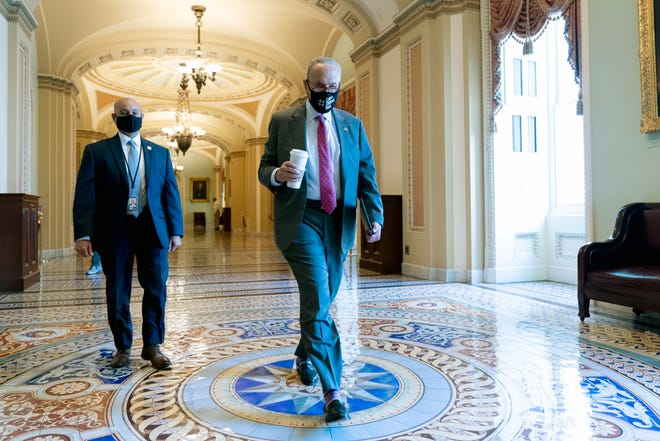 Senate Majority Leader Chuck Schumer of N.Y., arrives as the $1 trillion bipartisan infrastructure package is expected to be voted on by the Senate this morning on Capitol Hill in Washington, Tuesday, Aug. 10, 2021. (AP Photo/Andrew Harnik)