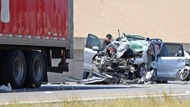 Damage to a vehicle can be seen at the site of a crash on the eastbound side of Houston Harte Expressway near Van Buren Street on Tuesday, Aug. 10, 2021.