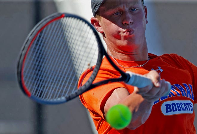 Sam Campassi returns a shot during a doubles tennis match for Central against Lubbock-Cooper on Tuesday, Aug. 10, 2021.