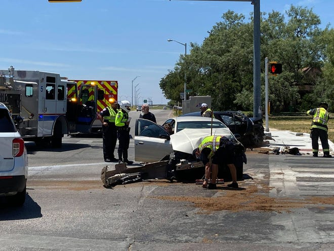 First responders investigate a crash on Howard and Dallas Streets on Tuesday, Aug. 10, 2021.