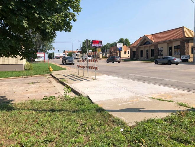 A curbed sidewalk blocks access to 23rd Street from Minnesota Avenue, and vice versa.