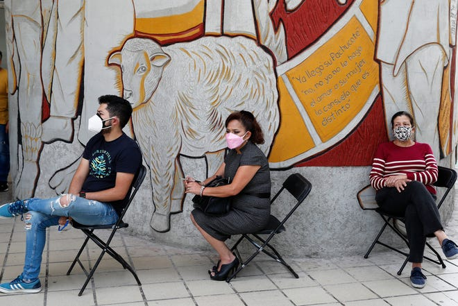 People wait to be tested for COVID-19 in Mexico City on Monday. The United States is sending more vaccines to Mexico to help the nation in its fight against the coronavirus.