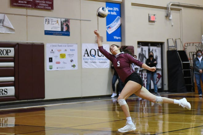 Bastrop's Crystal Creek chases down a ball in a game during a 2020 match. Creek had 11 kills in a loss to Wimberley Tuesday.