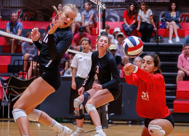 Lake Travis libero Emily Contreras digs the ball against San Antonio Churchill at the nondistrict volleyball game on Aug. 10 at Lake Travis High School. The Cavs won the match in five sets.