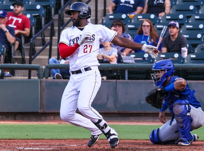 Round Rock Express third baseman Sherten Apostel drives the ball during the team's game versus the Oklahoma City Dodgers on Aug. 3. Apostel was promoted to the Triple-A squad from Double-A Frisco on Aug. 2.