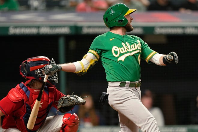 Jed Lowrie watches his RBI double during the 10th inning of the Oakland Athletics' 4-3, 10-nning win over Cleveland on Tuesday night. [Tony Dejak/Associated Press]