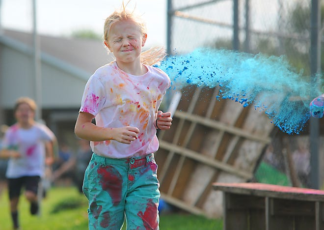 The inaugural Greater Alliance Carnation Festival Youth Color Run was held Tuesday, Aug. 10, 2021, at First Christian Church in Washington Township.