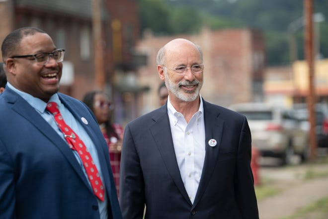 Gov. Tom Wolf, right, stands beside Aliquippa Mayor Dwan Walker on Wednesday in Aliquippa. Wolf visited the city to discuss ways Aliquippa will use the $11 million in state grants it has received since 2015.