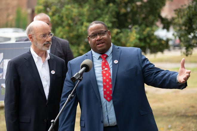 Aliquippa Mayor Dwan Walker, right, answers questions from the press on Wednesday during a visit from Gov. Tom Wolf, left, to discuss ways the city will use the $11 million in state grants it has received since 2015.
