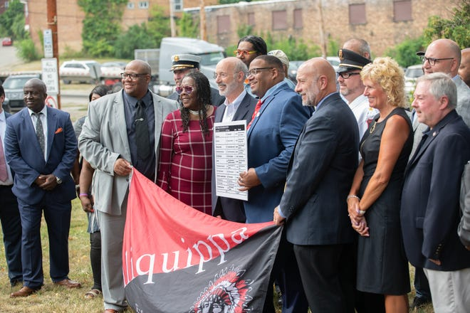 Gov. Tom Wolf stands with local leaders during his visit to Aliquippa on Wednesday. Leaders spoke with the governor about ways the city will use the $11 million in state grants it has received since 2015.