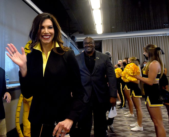 New Missouri athletic director Desiree Reed-Francois waves at the crowd before she is introduced during a news conference Aug. 11 at Memorial Stadium.