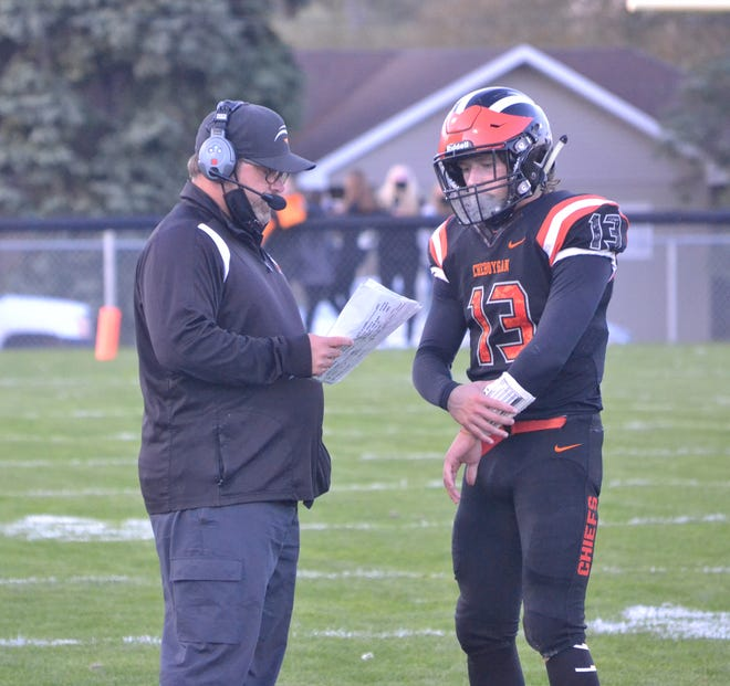 Cheboygan head coach Dave Schulz, left, talks with quarterback Henry Stempky during a varsity football contest from 2020. Cheboygan will host rival Petoskey in its season opener on Friday, Aug. 27.