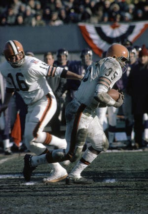 Jan 4, 1970; Bloomington, MN, USA, FILE PHOTO;  Cleveland Browns quarterback Bill Nelsen (16) hands off to Bo Scott (35) against the Minnesota Vikings during the 1969 NFL Championship Game at Metropolitan Stadium. The Vikings defeated the Browns 27-7. Mandatory Credit: Malcolm Emmons-USA TODAY Sports