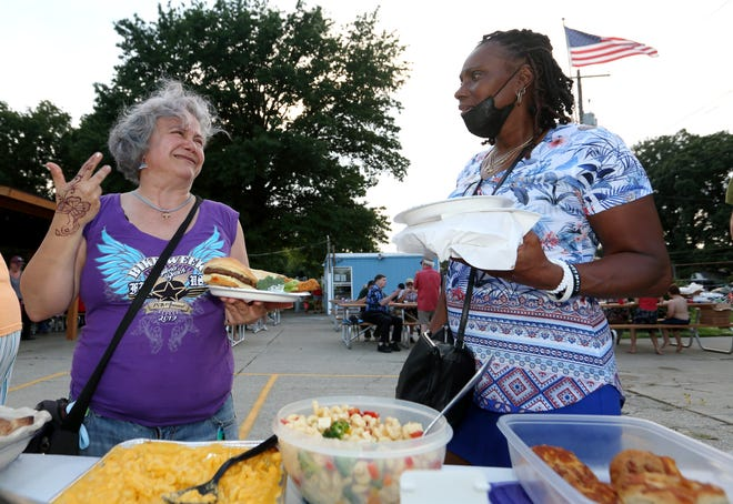 Jenny Leal (left), cofounder of Elevate Northland, chats with Northland resident Saretha McClure during the Northland Community Cookout on Aug. 10 at the Northland Swim Club.