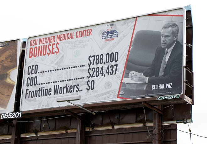 A billboard on Route 315 near the Lennox shopping center claiming that Ohio State Wexner Medical Center executive leaders got bonuses during the pandemic when front line workers did not.