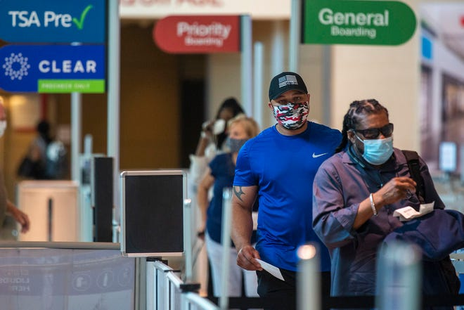 Southwest Airlines says it believes the surge in COVID-19 cases is causing passenger bookings to slow.
