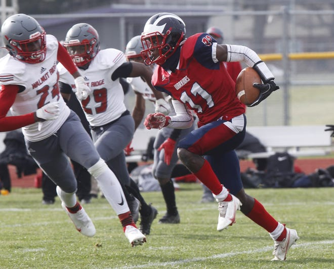 Eastmoor Academy's Isaiah Pressley carries the ball during a 14-6 loss to Walnut Ridge in last season's City League championship game. Pressley, a senior, is the top returning wide receiver for the Warriors.