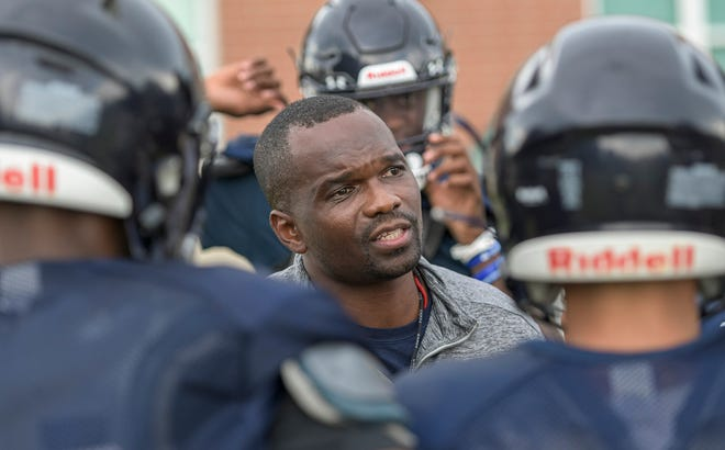 Eustis head coach Frank Scott talks with his players during Tuesday's practice at Eustis High School in Eustis. [PAUL RYAN / CORRESPONDENT]