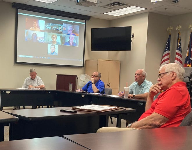 Guernsey County Commissioners, from left, Skip Gardner, Dave Wilson and Jack Marlin joined Guernsey County Community Improvement/Port Authority Executive Director Norm Blanchard for a Zoom meeting with officials from Ohio Mid-Eastern Governments Association and Reid Consulting Group to discuss broadband service in the county.