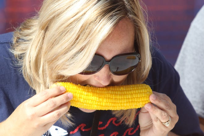 Jill Kruse of West Point enjoys an ear of corn Aug. 9, 2018, during the first day of West Point's Sweet Corn Festival, which runs through Sunday in downtown West Point.