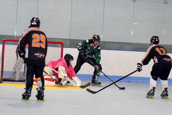 The Mad Hatters and The Sharp Shack squared off in the consolation game of the Judith Lajoie Memorial Cup as the Sharp Shack Inline Hockey League's inaugural season came to a close at Gardner Veterans Arena on Friday, Aug. 6.