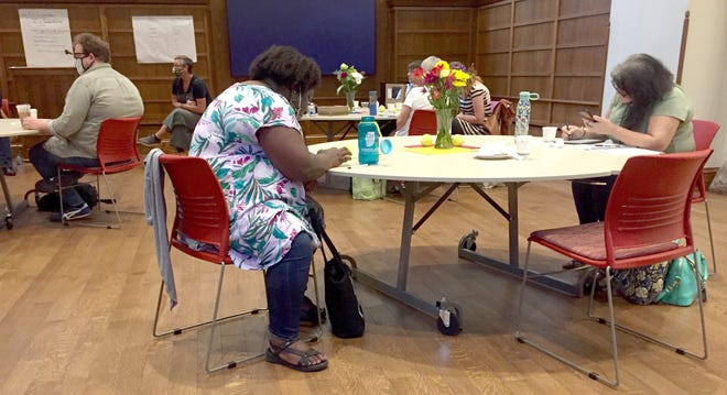 Participants wrap up their notes last weekend and prepare for a lunchtime talk by On-Ramp panelists at Indiana University's Maxwell Hall.