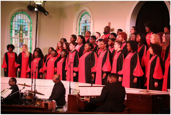 """Members of the Indiana University African American Choral Ensemble sing during filming of """"Amen! Music of the Black Church"""" at Second Baptist Church in Bloomington."""