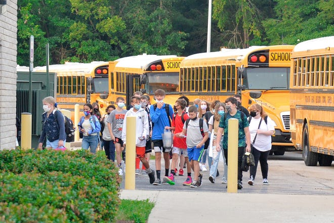 A group of students arrive at Edgewood Junior High School Aug. 11, ready for their first day of school in Ellettsville.