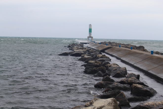 The pier at Holland State Park greets waves from Lake Michigan on Wednesday, Aug. 11, 2021, in Park Township, Mich. A group of Senate Democrats want party leadership to include $2.5 billion for infrastructure upgrades in the Great Lakes and across the U.S. in an upcoming reconciliation bill.