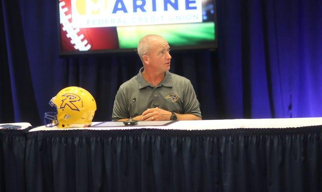 Richlands coach Pat Byrd speaks Monday during the Marine Federal Credit Union Football Jamboree Coaches meeting.