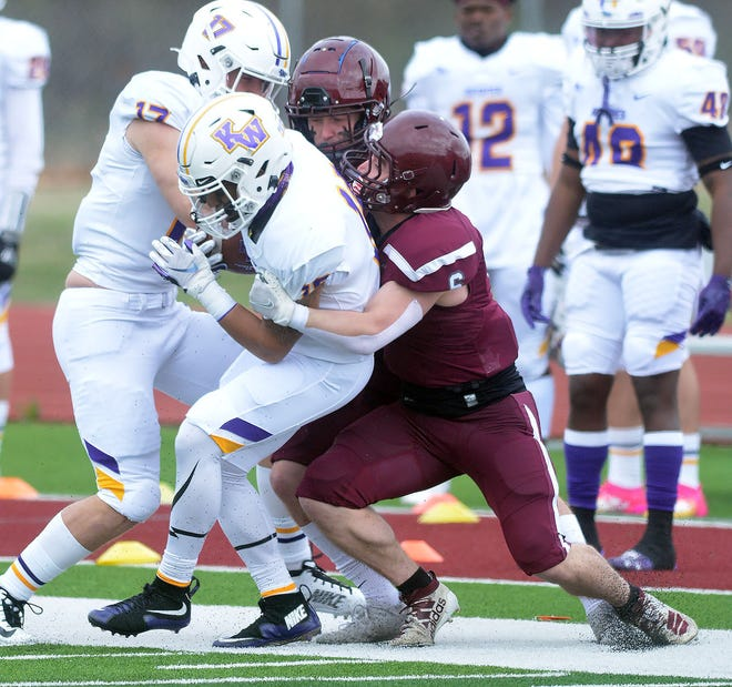 Bethel sophomore J.C. Shelton wraps up a Kansas Wesleyan ball carrier during play last spring at Thresher Stadium. Bethel was named the favorite in both the KCAC pre-season coaches and media polls.