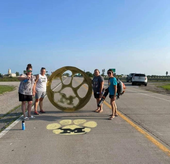 Parents of Marceline Senior Softball players spent time earlier this week taking part in an annual tradition - painting Tiger paws in front of the homes of softball players. Paws are painted on the roadoutside of athlete's homes before the start of each season. Varsity softball will kick-off their season with a Jamboree on Aug. 21, junior varsity will have a jamboree on Aug. 28. Both teams will take onPenney High School, at 5 p.m., on Aug. 30 at Penney.
