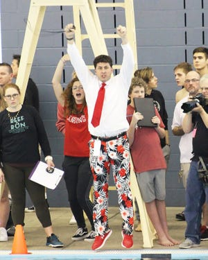 Coach David Bresser coaches swim teams at the University of Saint Mary as well as Lansing High School and Basehor-Linwood High School. He is known for his colorful apparel.
