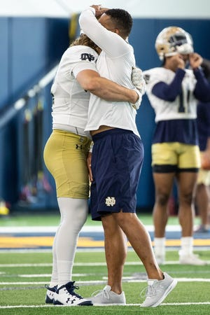 Notre Dame defenders, such as linebacker Bo Bauer (left), have embraced first-year Irish defensive coordinator Marcus Freeman and his new philosophy.