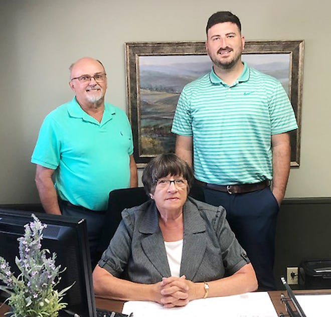 Darryl Tinges, left, Cil Nagel and Danny Schahrer are shown at the Country Financial office in Fairbury.