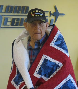 GAYLORD — The Patriotic Quilters of Gaylord presented a host of quilts of valor to area veterans last month at the Gaylord Regional Airport.  Among the recipients of a quilt was Thomas Long.  Long grew up on a farm north of Boyne City. From there, he was drafted into the U.S. Army and sent to Korea. He built roads in the Cumwa Valley as a 378 combat engineer. Ten years later, Thomas enlisted in the U.S. Navy and was sent to Vietnam. He was a 3rd class Boatswain's Mate, patrolling the coastline and intercepting messages.  Now, Long is married to wife, Nancy, and they have two children in Thomas Jr. and Kevin. They are also blessed with four grandchildren. Long worked for the Gaylord Community Schools for 30 years. He enjoys fishing and hunting.
